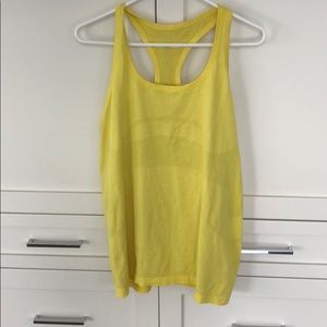 Like new, Lululemon banana yellow tank.